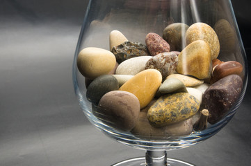 decorative pebbles in glass containers