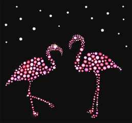 Two pink flamingos made with precious gems on black background