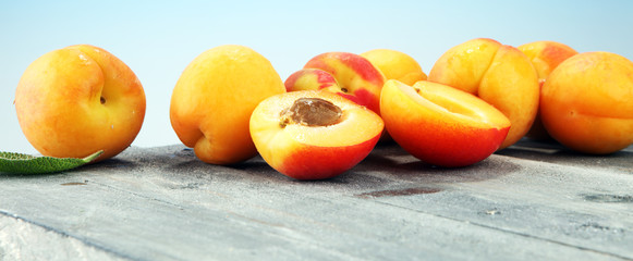 Delicious ripe apricots on wooden table. Fresh cut apricot fruits