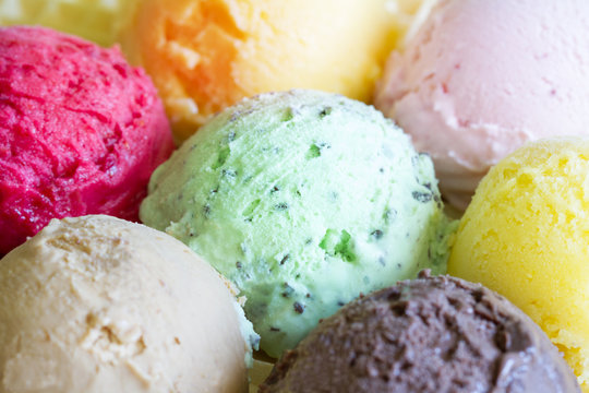 Colorful scoops ice cream background concept closeup