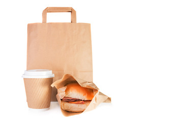 Brown paper carrier bag, take away paper cup, bacon roll in a take away wrap