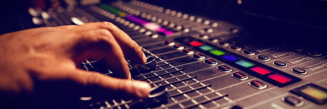 Cropped hand of musician using sound mixer
