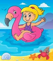 Girl floating on inflatable flamingo 4