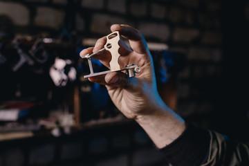 Worker holds body for tattoo of handmade machine