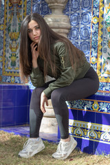 Beautiful young brunette in a courtyard with Valencian tiles