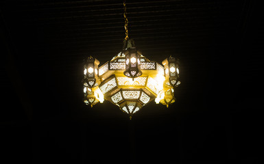 Ornamental  Moroccan, Arabic lantern . Greeting card for Muslim holy month Ramadan Kareem. Festive background.
