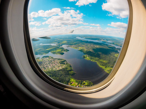 View of the planet Earth through the airplane porthole