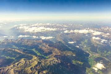 Scenic flight on Alps mountain range in Italy. Aerial view of Alpi mountains.
