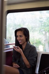 Woman talking on mobile phone in the bus