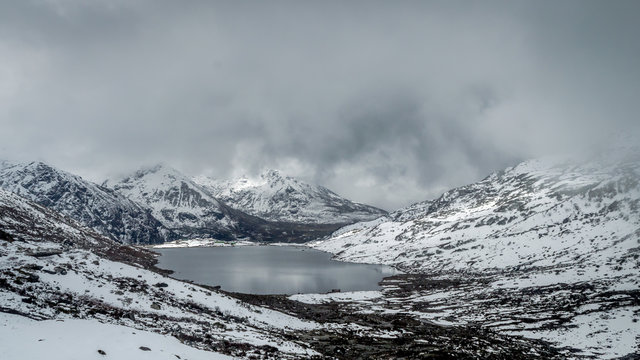 Sarathang lake surrounded by snow covered mountains on all side near Changu lake in May, Sikkim, India