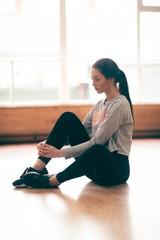Female dancer relaxing in dance studio