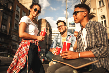 Group of friends hangout at the street.They  drinking cold juice.Fast food concept.