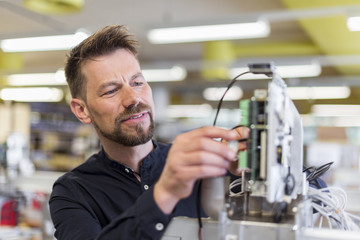 Man in factory working on device