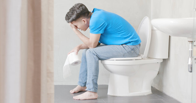 man feel pain with constipation