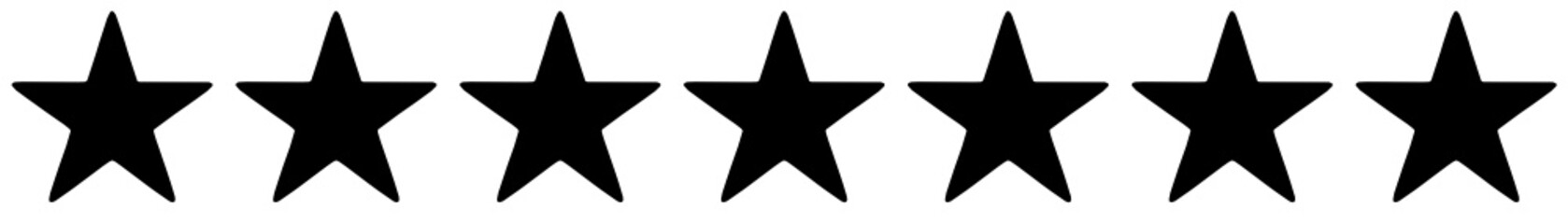 Row of seven black stars on a white Wall mural