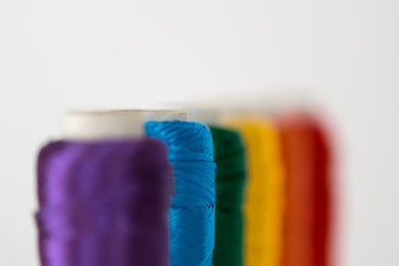 Rainbow flag. LGTB symbol made with colorful spools of thread. Selective focus.