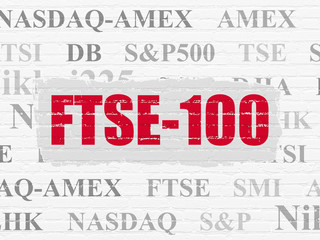 Stock market indexes concept: Painted red text FTSE-100 on White Brick wall background with  Tag Cloud