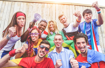 Happy sport supporters having fun during football world game