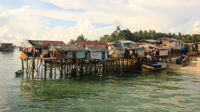 Poor fishing village in Asia, at risk from climate change and rising sea levels