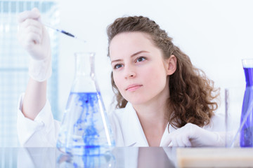 Woman chemist making a mixture