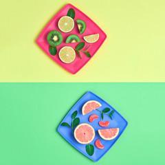 Lemon Kiwi Grapefruit Fresh Fruit with Green Mint leaves on plate. Vegan food Organic Concept. Creative Flat lay. Trendy fashion Style. Minimal Design Art. Summer Bright Color.