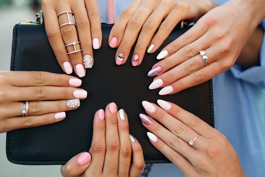 Different fashionable and trendy manicure with design on girl s hands.