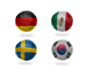 group F. football balls with national flags of germany, mexico, sweden, south korea. soccer teams