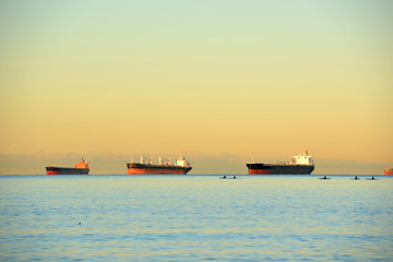 Oil Tankers docked at Port of Vancouver at sunrise in Vancouver, British Columbia, Canada.