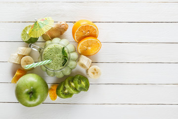 Fresh milkshake of tropical fruits, green apple, lime and mint. Top view. The concept of a healthy diet. Copy space