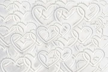Many hearts drawing on white winter snowy background