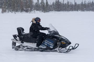 Man driving a snowmobile, Yellowknife, Northwest Territories, Canada