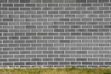 Gray brick wall on lawn grass