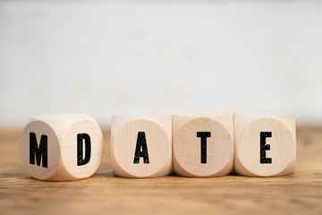 Cubes with letters show, that MATE and DATE could be very close together