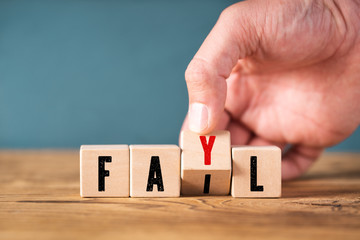 "Hand corrects spelling of the word ""fail"""