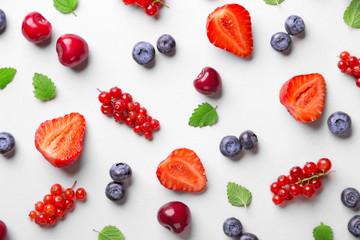 Fruit pattern on a white background (strawberry, blueberry, red currant, cherry). Top view