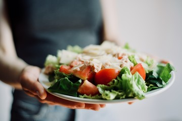 hands and dish, woman eating healthy food fresh beutiful organic tasty salad, detox, dieting, nutrition, fitnexx food