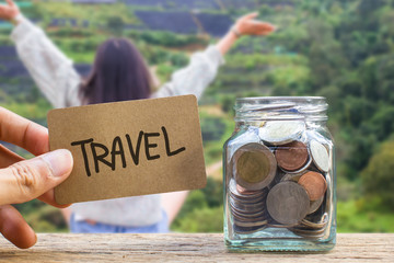 Conceptual saving money for travel with blurred happy time vacation as background.