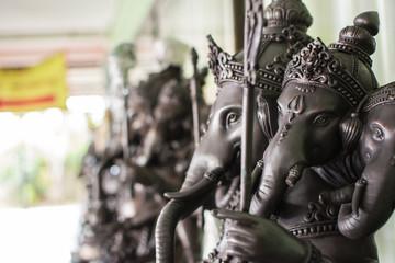 Close up black Ganesha statue and gray texture ganesh is hindu god of Success