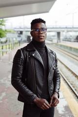 Black man standing on platform