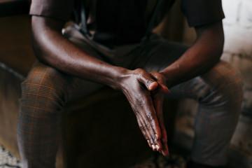 Black man folding hands together