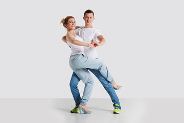 beauty couple dancing  on grey background.