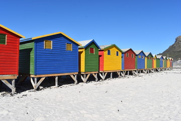 Colorful bathing cabins on the beach in Muizenberg in Cape Town, South Africa