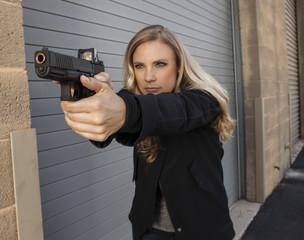 Female shooter aiming gun.