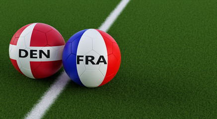 Denmark vs. France Soccer Match - Soccer balls in Denmarks and France national colors on a soccer field. Copy space on the right side - 3D Rendering