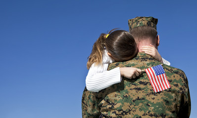 Military Father Hugging His Daughter With An American Flag