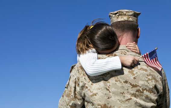 Military Man Hugging His Daughter