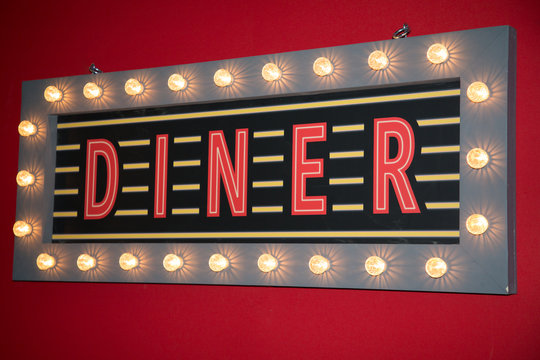Diner neon sign road on restaurant wall