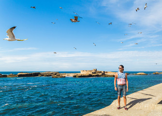 A model posing in the fishing port of Essaouira, Morocco