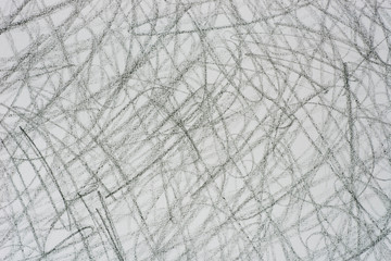 gray crayon doodles on paper background texture