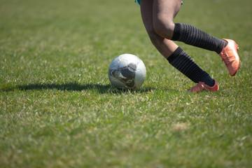 Soccer Player Dribbling a ball